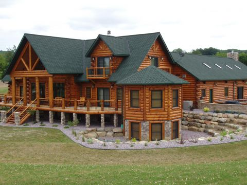 Refinishing log cabins & homes in Rockford & Millwood